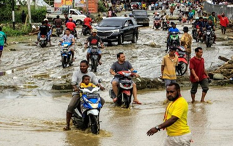 Flash floods kill at least 77 people in Indonesia